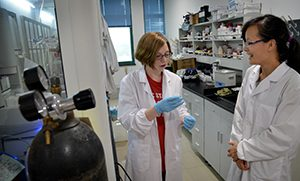 Chemical engineering major Olivia Gordon of Cary chats with her mentor in her Zhejiang University lab.
